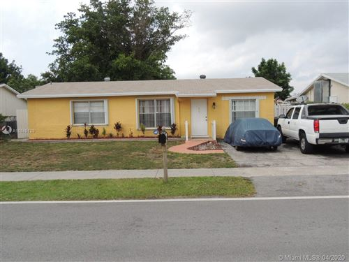 Photo of 7607 Kimberly Blvd, North Lauderdale, FL 33068 (MLS # A10845129)