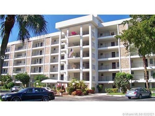 Photo of 2751 N Palm Aire Dr #406, Pompano Beach, FL 33069 (MLS # A11005130)