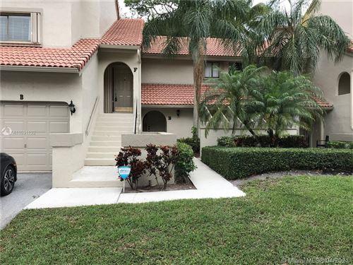 Photo of 5580 Coach House Cir #F, Boca Raton, FL 33486 (MLS # A11031132)