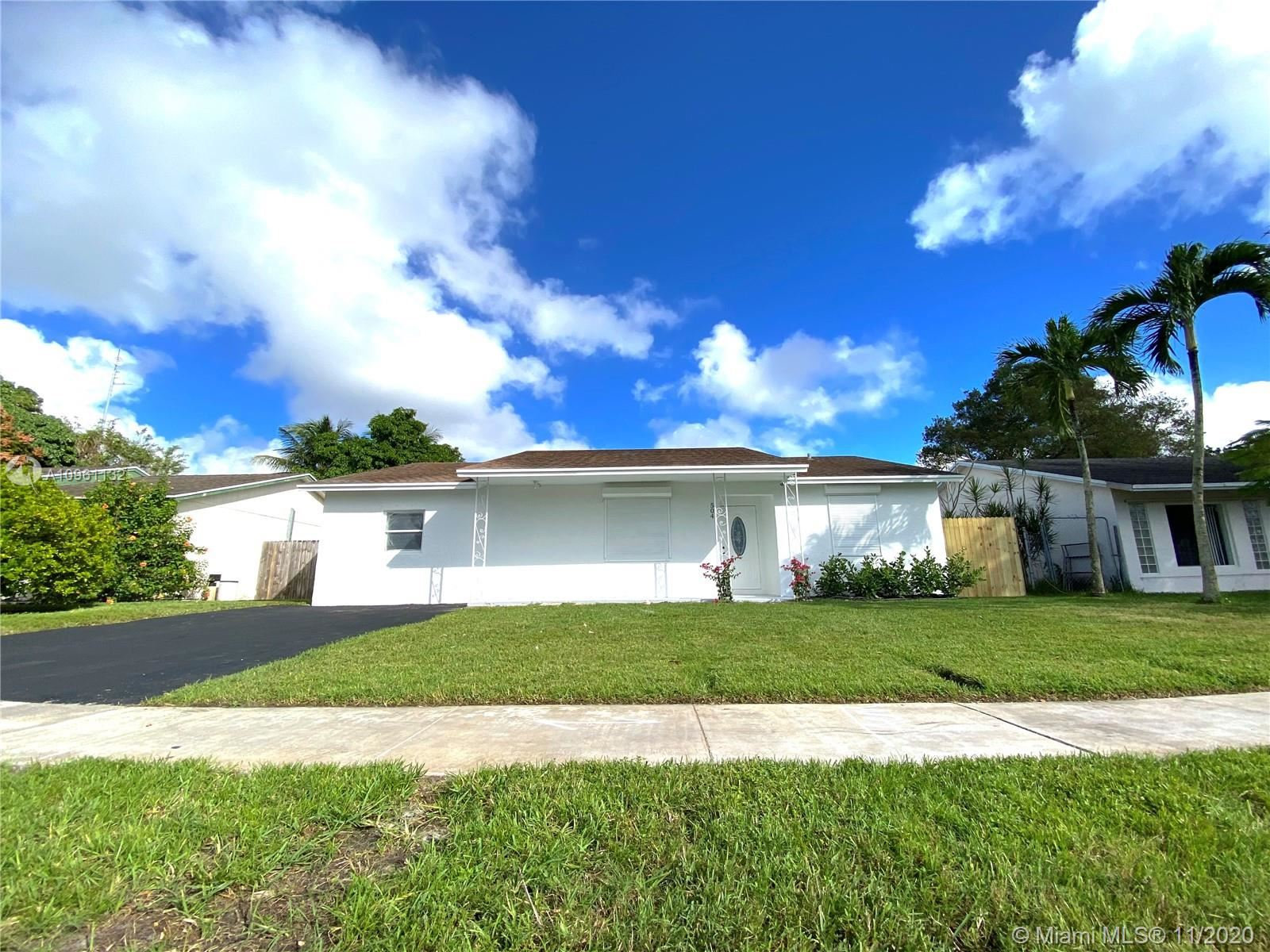Photo of 504 SW 76th Ter, North Lauderdale, FL 33068 (MLS # A10961132)