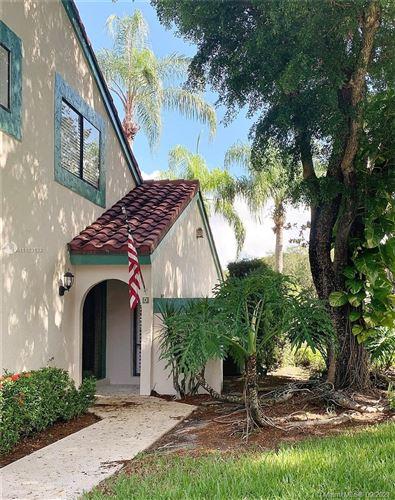 Photo of 4 E Lexington Ln E, Palm Beach Gardens, FL 33418 (MLS # A11103133)