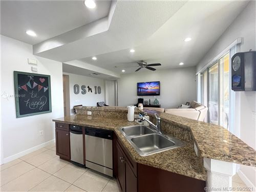 Photo of 12782 NW 83rd Ct #36-C, Parkland, FL 33076 (MLS # A11095137)