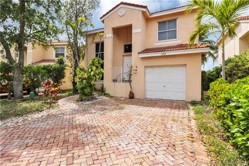 Photo of 3424 NW 109th Way, Coral Springs, FL 33065 (MLS # A10841138)