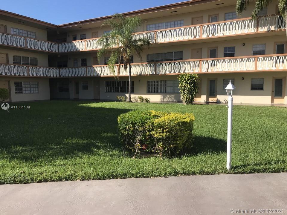 Photo of 11855 NE 19th Dr #26, North Miami, FL 33181 (MLS # A11001138)