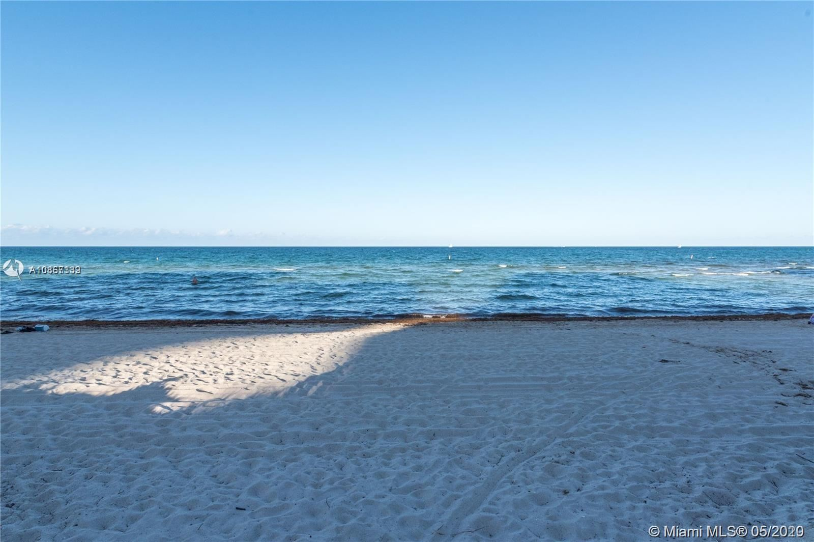 Photo of 8877 Collins Ave #503, Surfside, FL 33154 (MLS # A10867139)