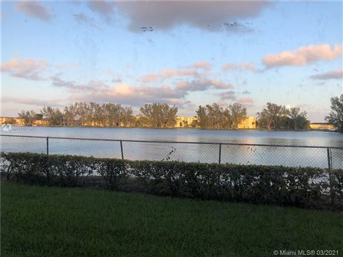 Photo of 9911 W Okeechobee Rd #1-101, Hialeah Gardens, FL 33016 (MLS # A11007140)