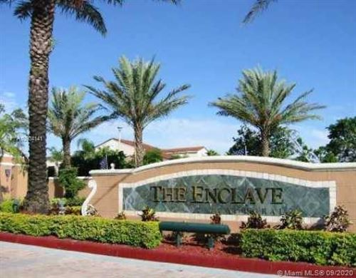 Photo of 4580 NW 107th Ave #207-13, Doral, FL 33178 (MLS # A10934141)