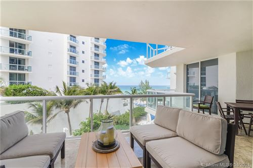 Photo of 18671 Collins Ave #404, Sunny Isles Beach, FL 33160 (MLS # A10998141)