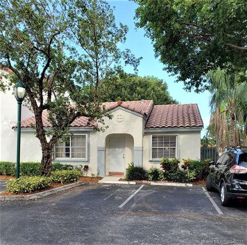 Photo of 1545 Springside Dr #1545, Weston, FL 33326 (MLS # A11041141)