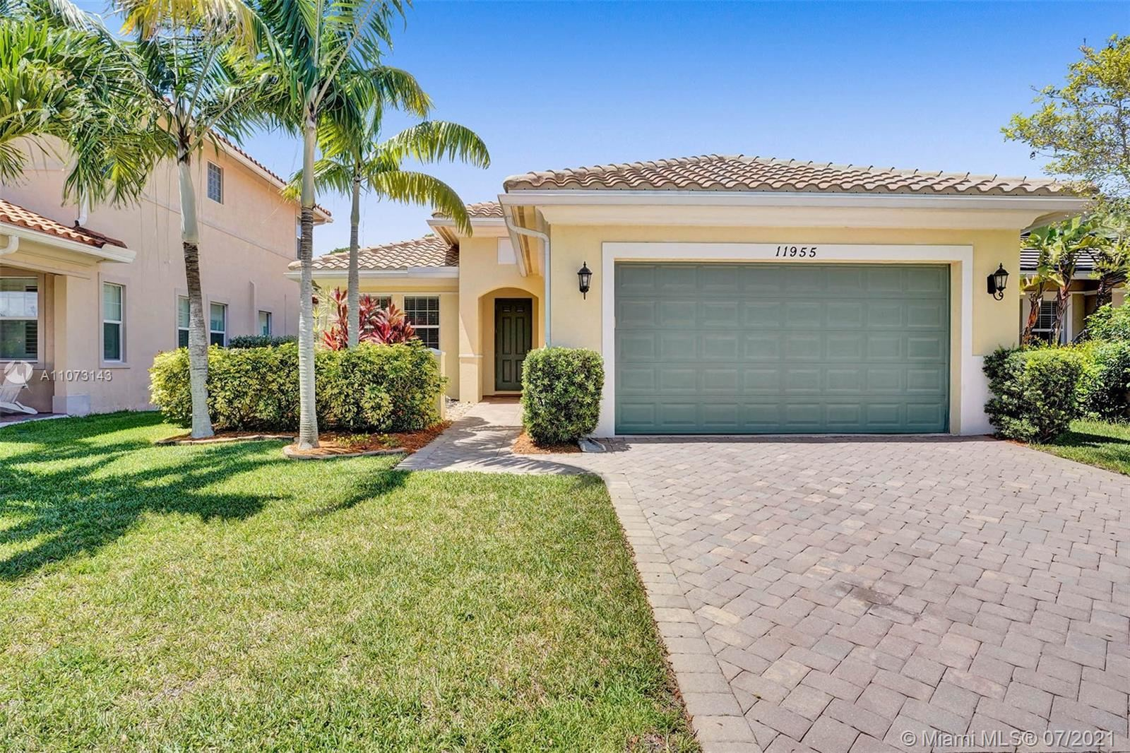Photo of 11955 NW 83rd Pl, Parkland, FL 33076 (MLS # A11073143)