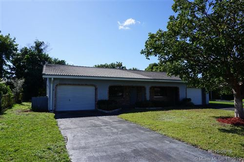 Photo of 8938 NW 27th St, Coral Springs, FL 33065 (MLS # A10777145)