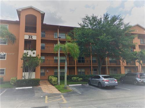 Photo of 701 SW 141st Ave #305R, Pembroke Pines, FL 33027 (MLS # A11026150)