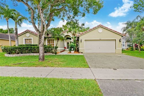 Photo of 7341 NW 44th Ln, Coconut Creek, FL 33073 (MLS # A10875151)