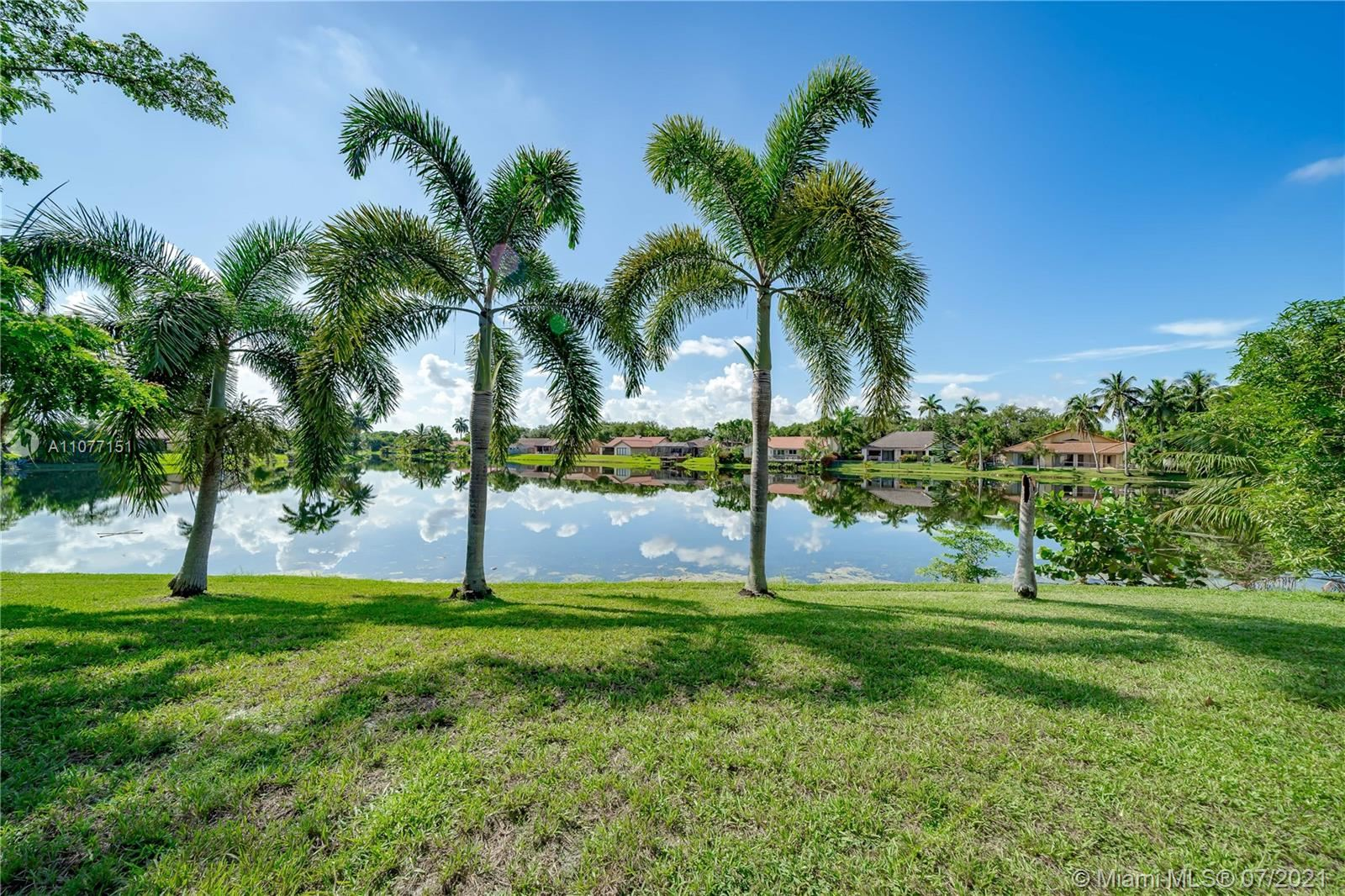 Photo of 1048 NW 99th Ave, Plantation, FL 33322 (MLS # A11077151)