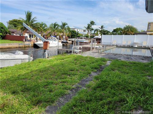Photo of 13080 Ortega Ln, North Miami, FL 33181 (MLS # A11079152)