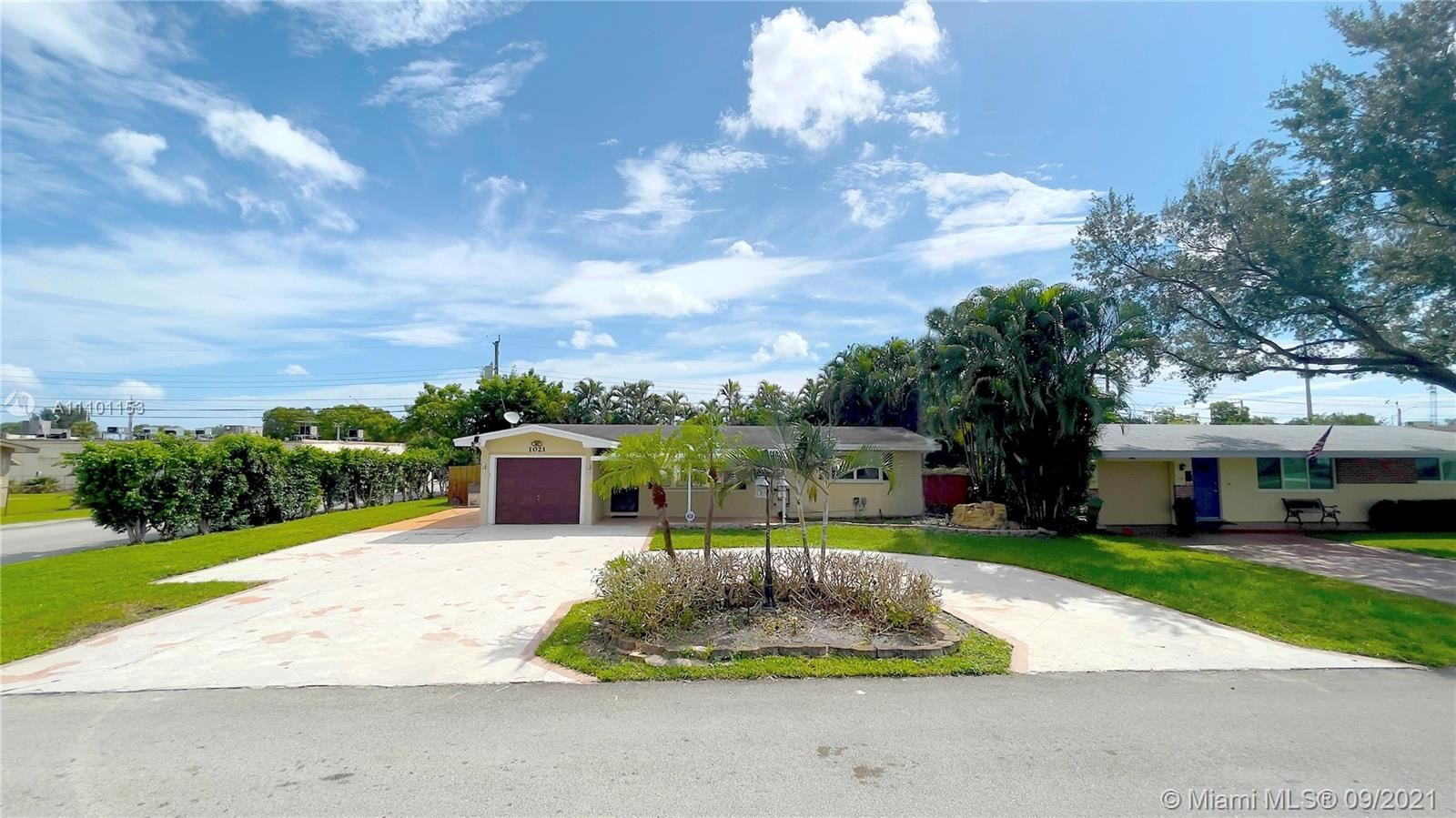 Photo of 1021 NW 81st Ave, Pembroke Pines, FL 33024 (MLS # A11101153)
