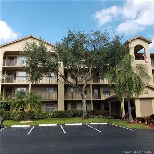 Photo of 12501 SW 14th St #213R, Pembroke Pines, FL 33027 (MLS # A10889154)