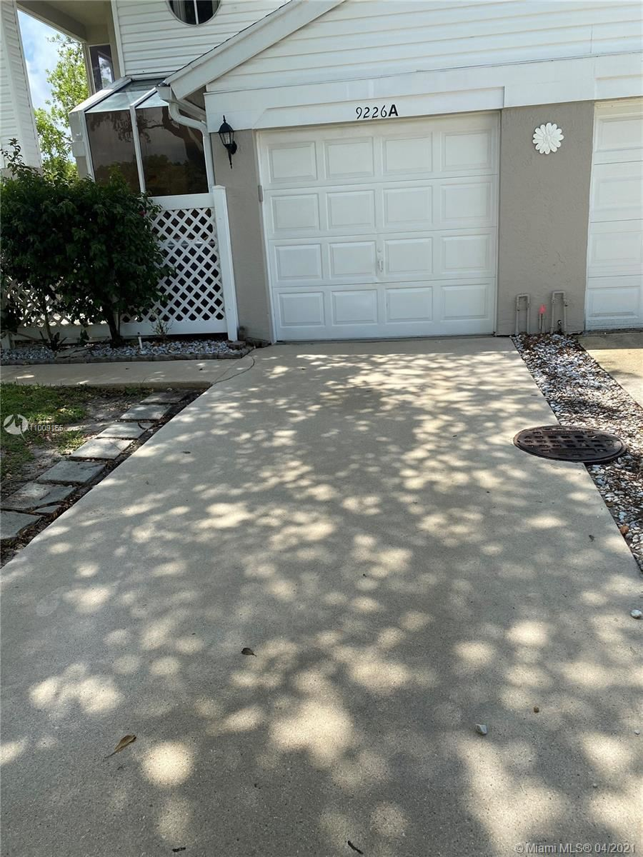 Photo of 9226 Boca Gardens Pkwy #A, Boca Raton, FL 33496 (MLS # A11009155)
