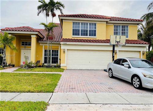 Photo of 1282 NW 195th Ave, Pembroke Pines, FL 33029 (MLS # A11052157)