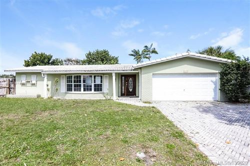 Photo of 1631 NE 56th Ct, Fort Lauderdale, FL 33334 (MLS # A10818158)