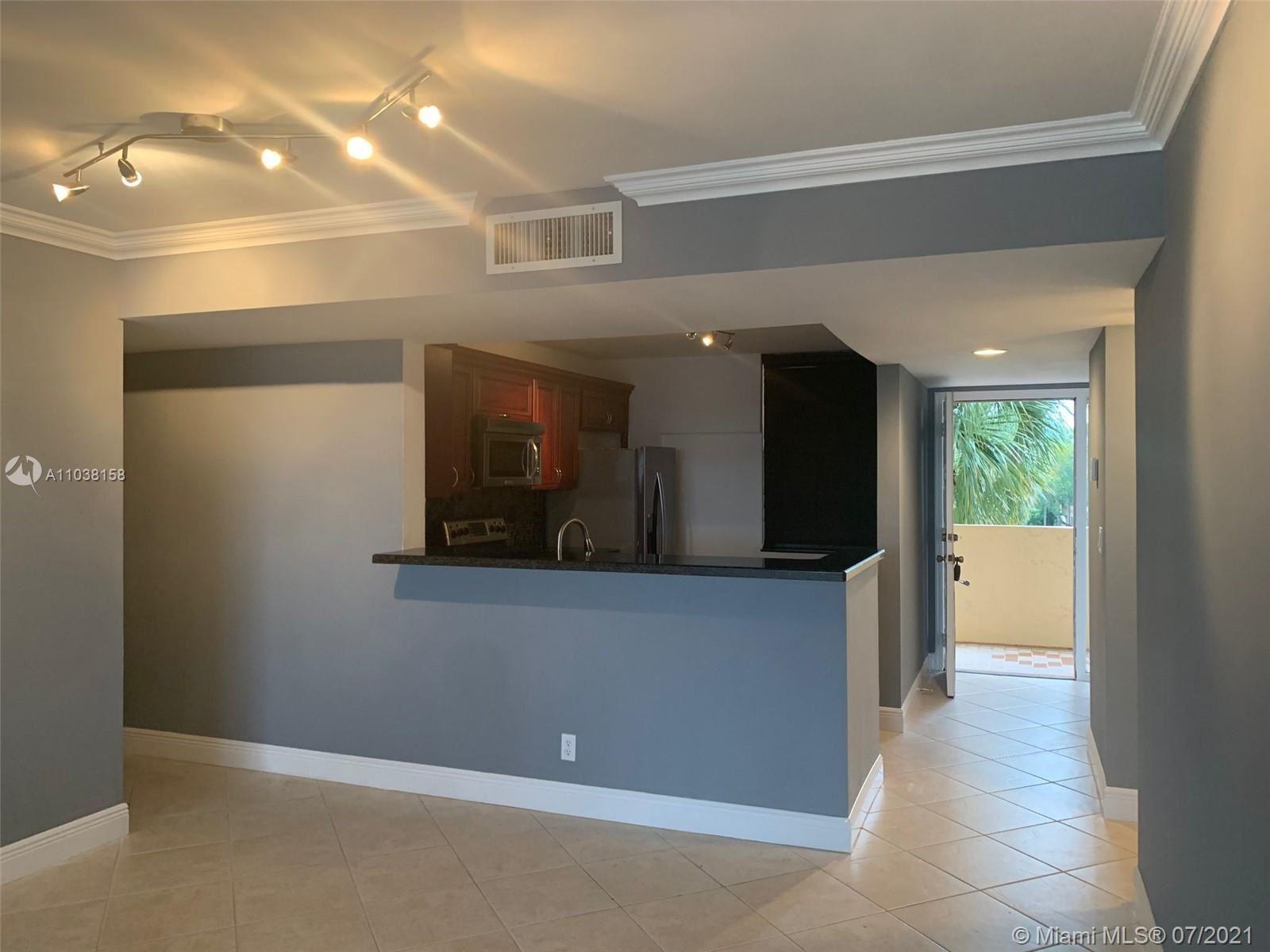 Photo of 2766 S Carambola Cir S #305, Coconut Creek, FL 33066 (MLS # A11038158)