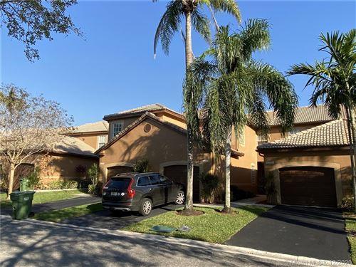 Photo of 1398 Coronado Rd, Weston, FL 33327 (MLS # A10965160)