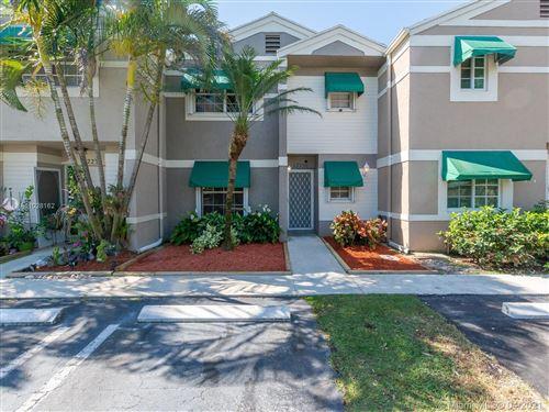 Photo of 12236 SW 52nd Pl, Cooper City, FL 33330 (MLS # A11028162)