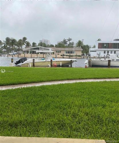 Photo of 301 Golden Isles Dr #110, Hallandale Beach, FL 33009 (MLS # A11100166)
