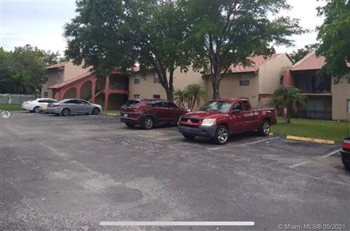 Photo of 716 SW 81st Ave #13A, North Lauderdale, FL 33068 (MLS # A11040167)