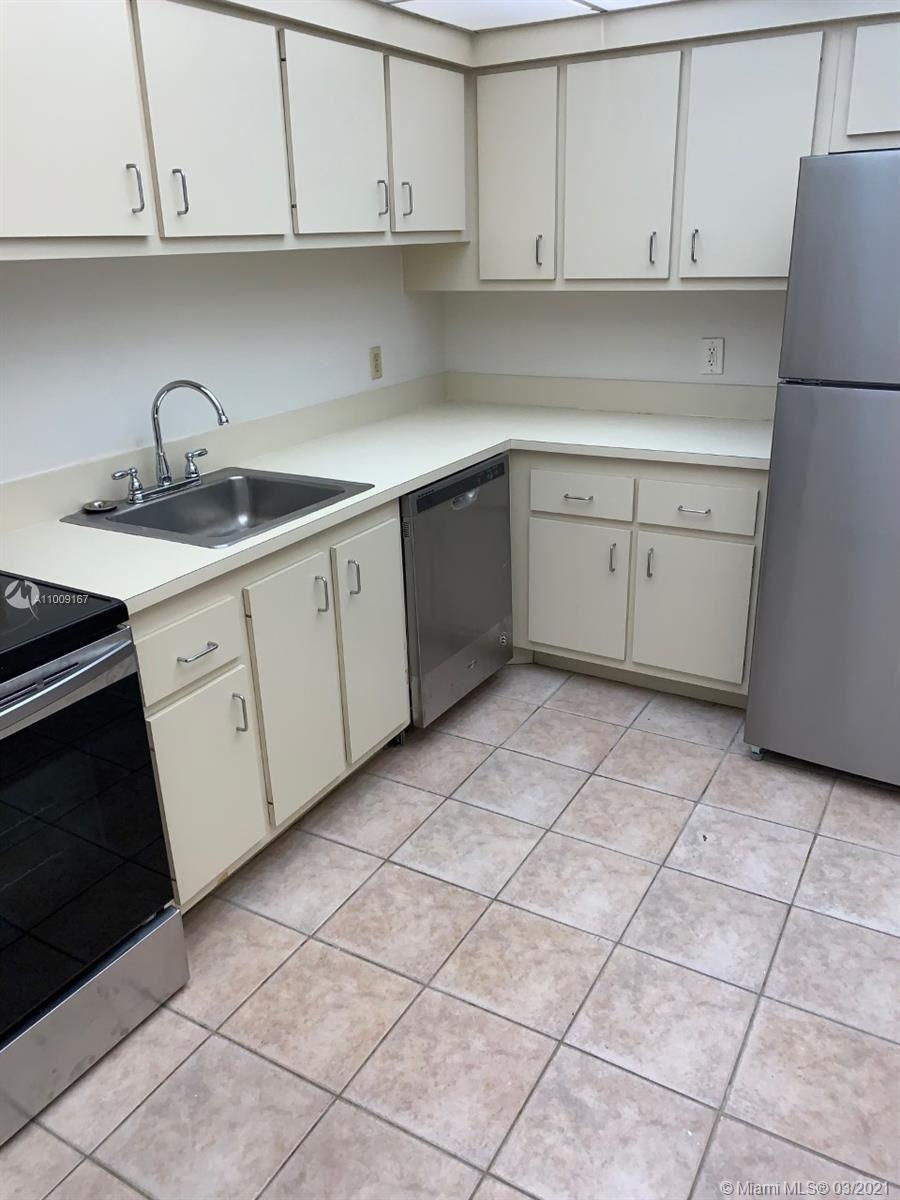 Photo of 4222 Inverrary Blvd #4813, Lauderhill, FL 33319 (MLS # A11009167)