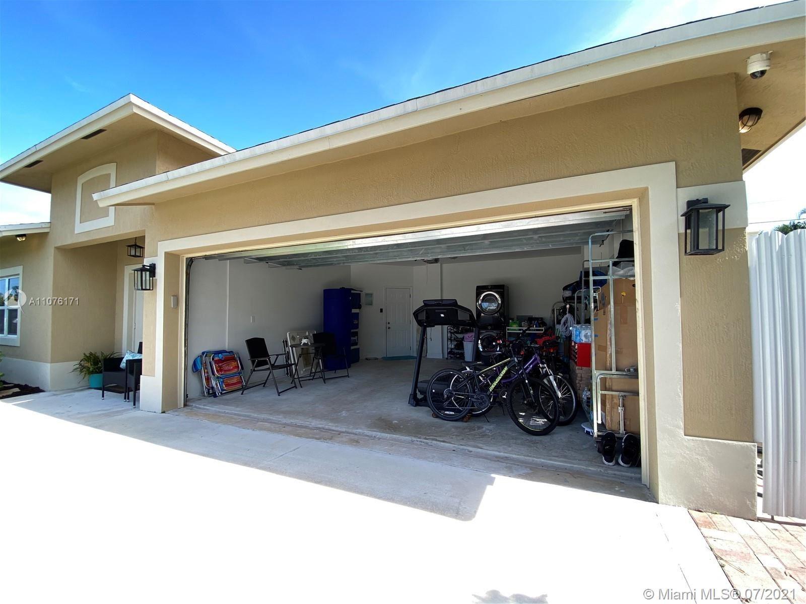 Photo of 1548 NE 31st Ct, Pompano Beach, FL 33064 (MLS # A11076171)