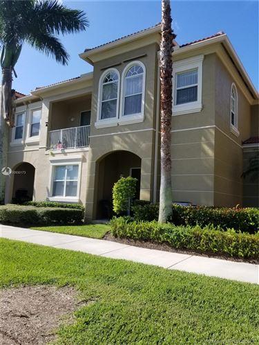 Photo of 4930 Bonsai Cir #100, Palm Beach Gardens, FL 33418 (MLS # A10930173)
