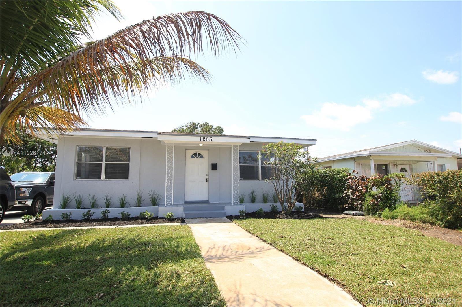 Photo of 1265 W 32nd St, Riviera Beach, FL 33404 (MLS # A11026174)