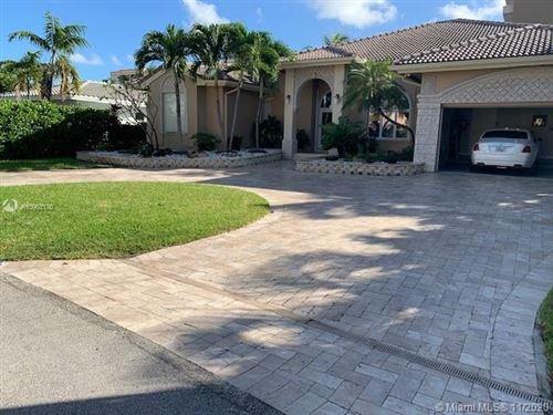 Photo of 2910 NE 164th St, North Miami Beach, FL 33160 (MLS # A10963176)