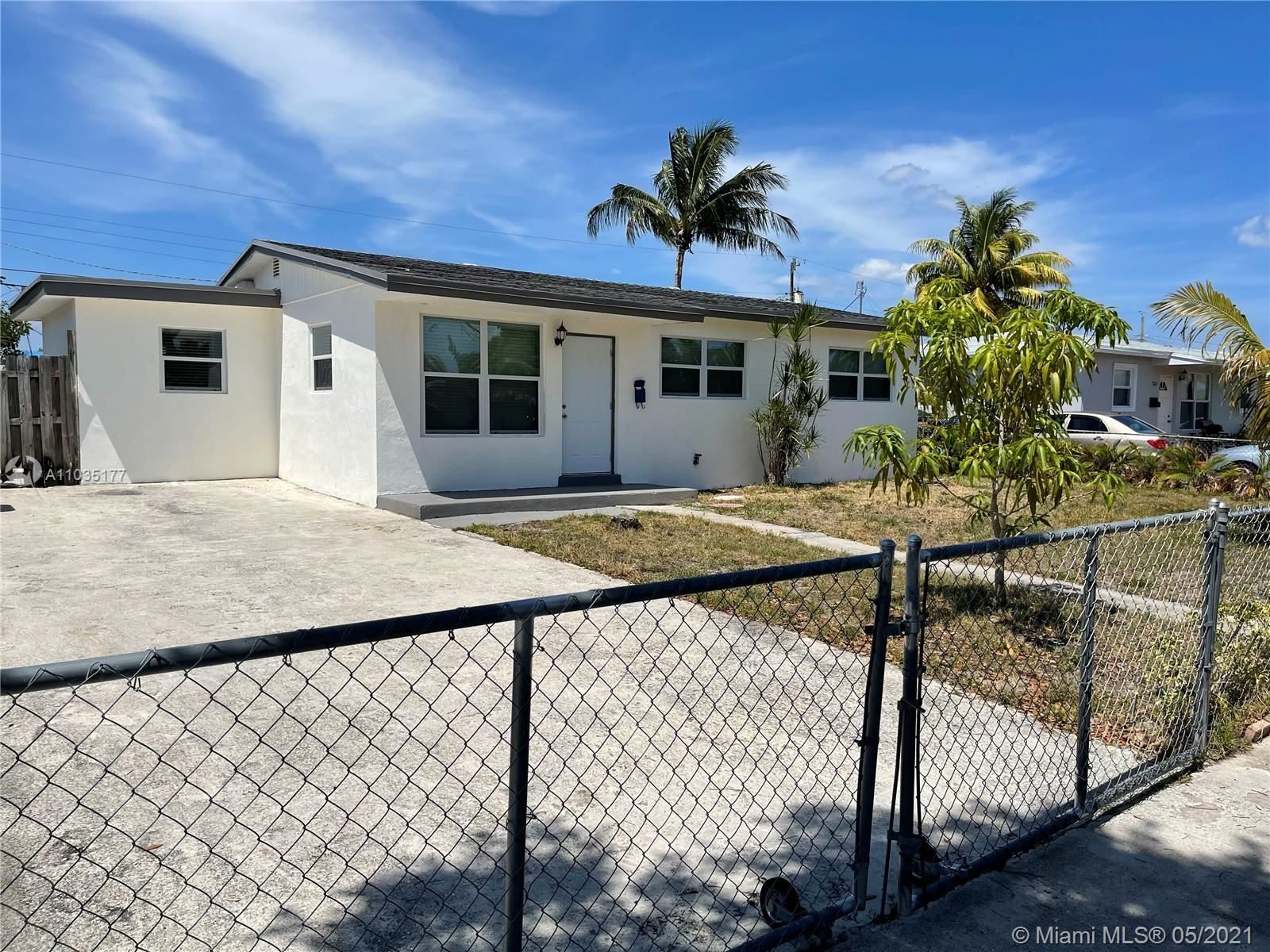 Photo of 7351 Garfield St, Hollywood, FL 33024 (MLS # A11035177)