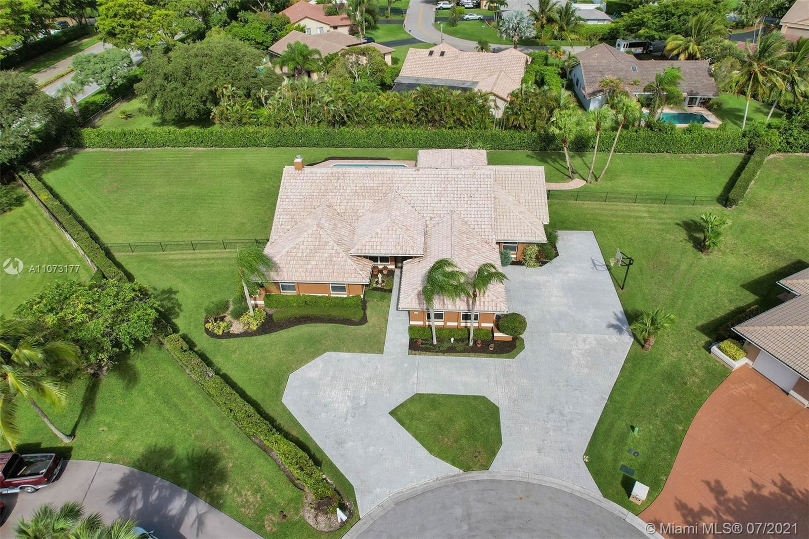 Photo of 8251 NW 49th Ct, Coral Springs, FL 33067 (MLS # A11073177)