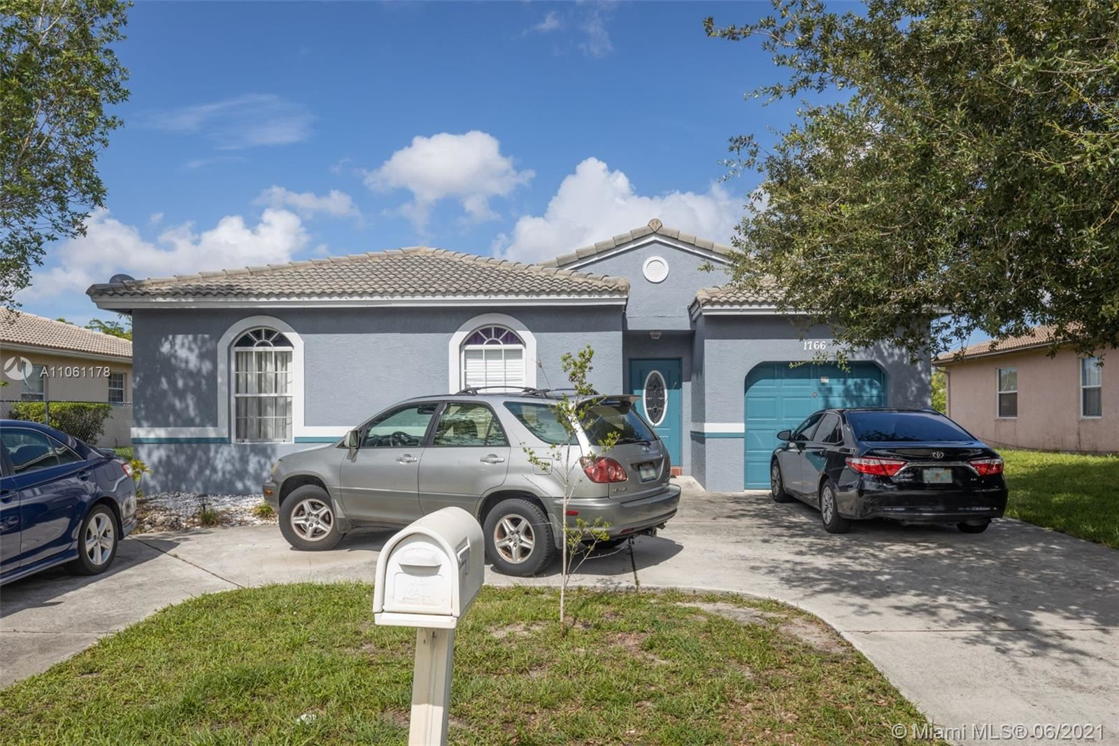Photo of 1766 NW 56th Ave, Lauderhill, FL 33313 (MLS # A11061178)