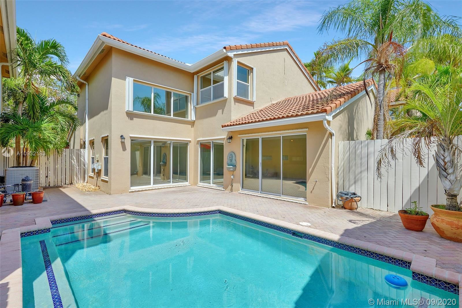 Photo of 1030 Scarlet Oak St, Hollywood, FL 33019 (MLS # A10932183)