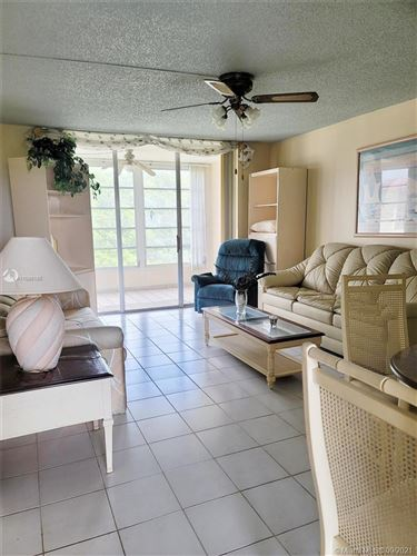 Photo of 3070 NW 48 TER #411, Lauderdale Lakes, FL 33313 (MLS # A11098185)