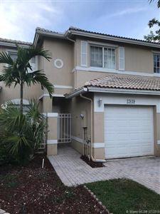 Photo of 17049 NW 23rd St #17049, Pembroke Pines, FL 33028 (MLS # A10705187)