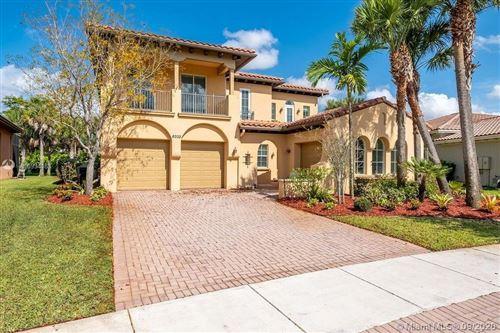Photo of Parkland, FL 33076 (MLS # A10934188)