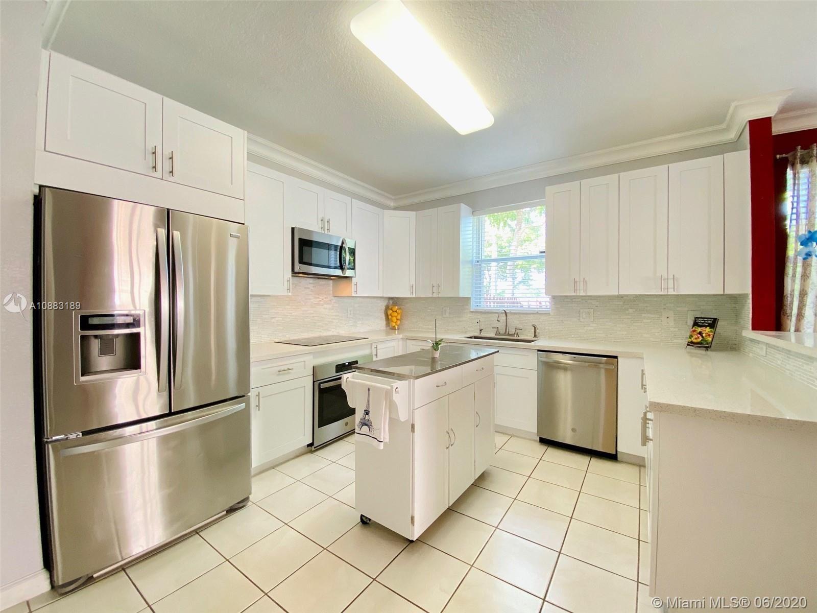 Photo of 21546 SW 92nd Pl, Cutler Bay, FL 33189 (MLS # A10883189)