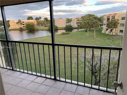 Foto de inmueble con direccion 210 Lakeview Dr #309 Weston FL 33326 con MLS A10825190