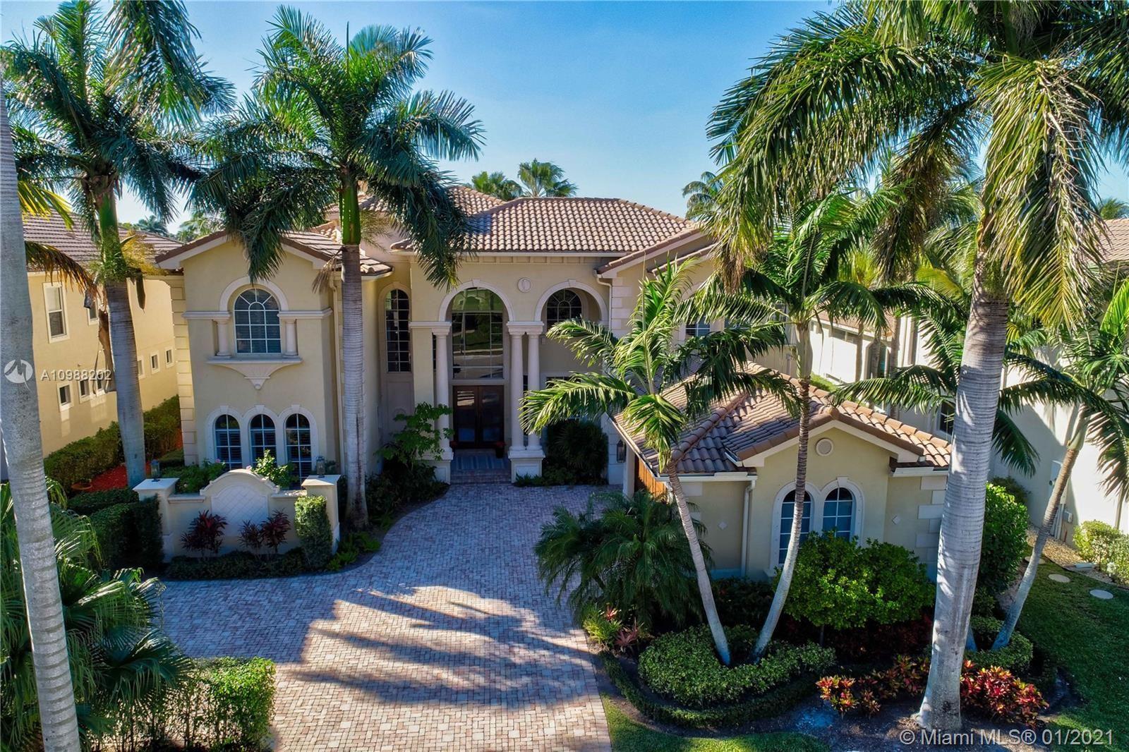 Photo of 421 Savoie Dr, Palm Beach Gardens, FL 33410 (MLS # A10988202)
