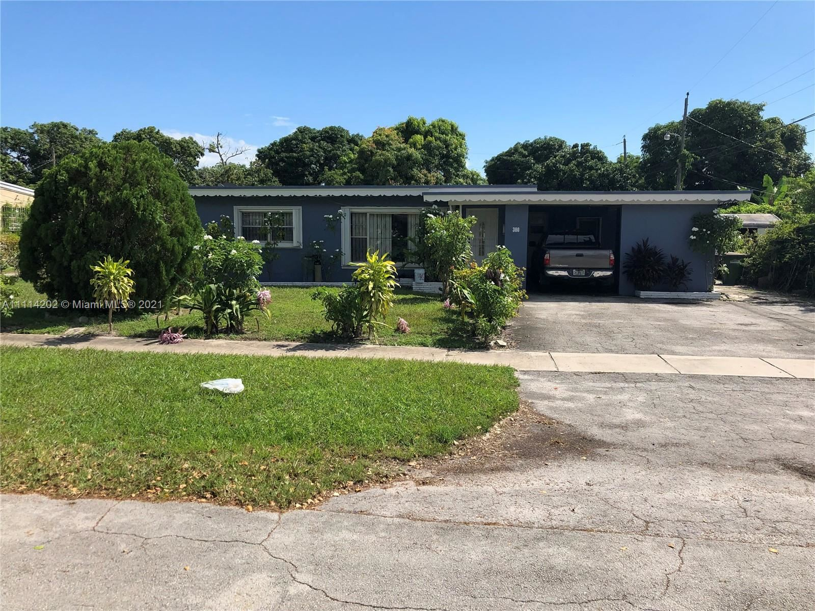 Photo of 380 NW 122nd St, North Miami, FL 33168 (MLS # A11114202)