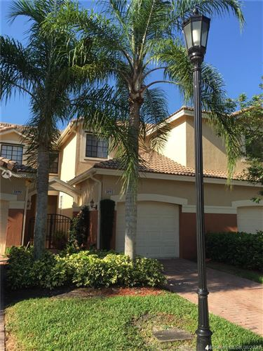 Photo of 3892 Tree Top Dr, Weston, FL 33332 (MLS # A10864204)