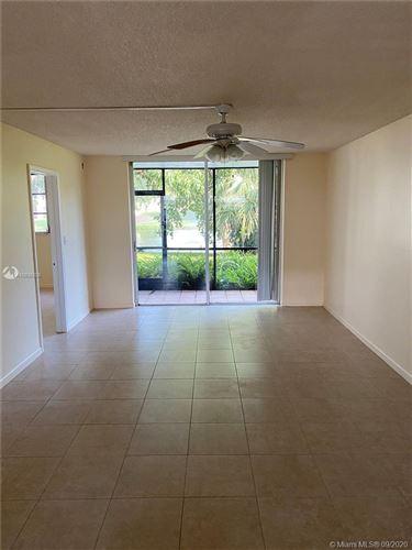 Photo of 820 S Hollybrook Dr #106, Pembroke Pines, FL 33025 (MLS # A10935205)