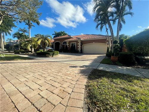 Photo of 8340 NW 157th Ter, Miami Lakes, FL 33016 (MLS # A10973207)