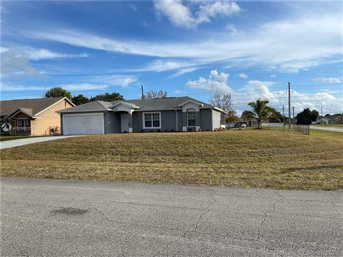 Photo of 486 SW Souris Ave, Port Saint Lucie, FL 34953 (MLS # A10988207)