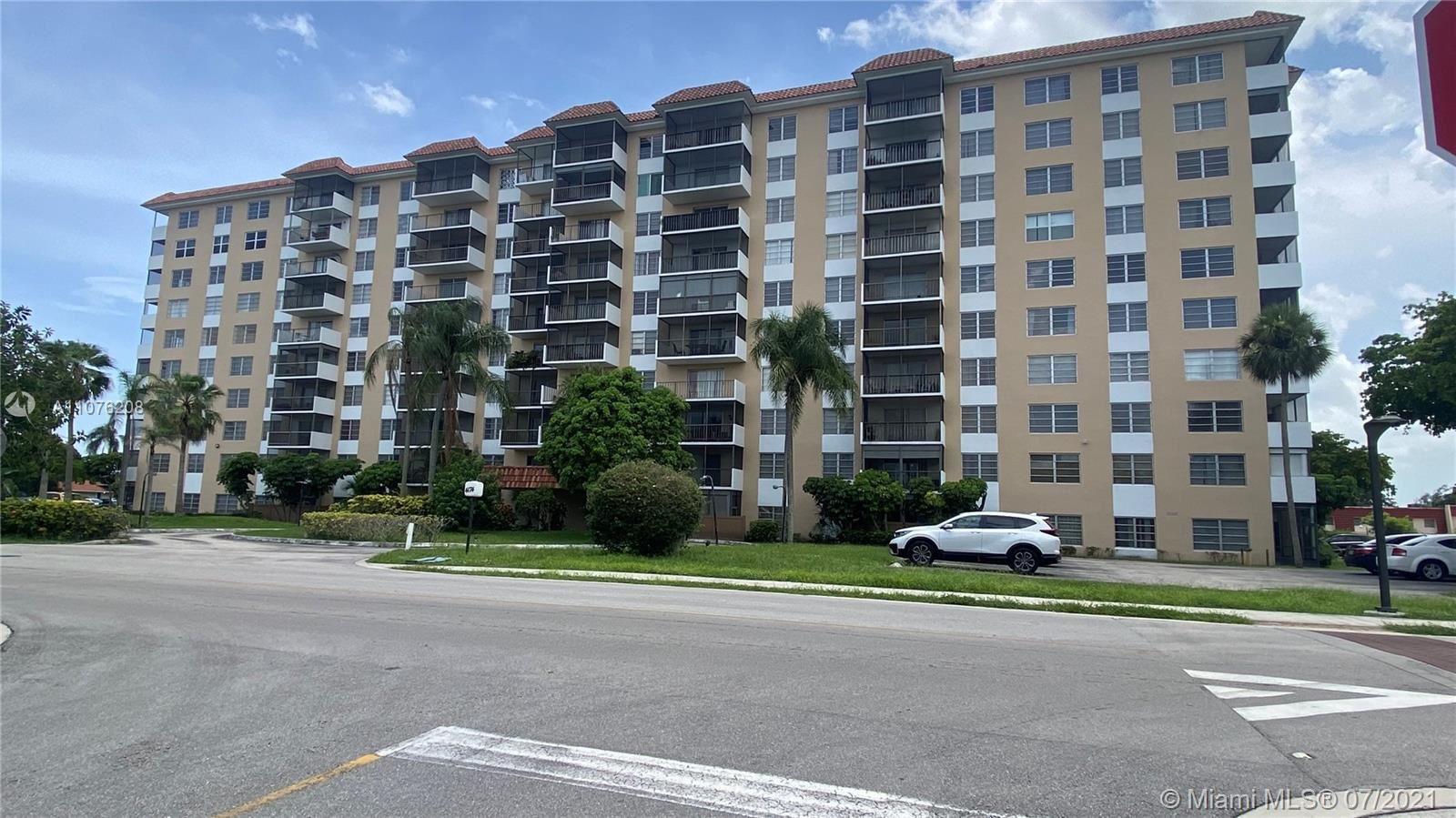 Photo of 4174 Inverrary Dr #306, Lauderhill, FL 33319 (MLS # A11076208)